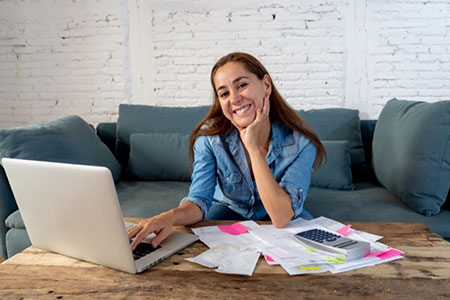 Woman Smiling with Laptop Image