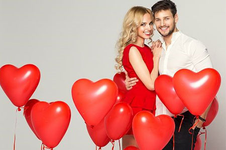 Couple Embracing with Red Heart Balloons Image